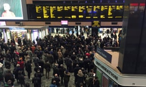 Passengers crowd the concourse at Euston station in London as heavy flooding in the Midlands led to severe rail disruption and overcrowding at the station.
