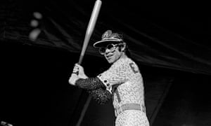 Elton in designer Bob Mackie's sequinned reimagining of the Los Angeles Dodgers uniform, playing at the Dodger Stadium in 1975