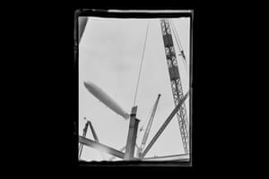 Zeppelin, London, c 1930, Cranes, construction works and a zeppelin in the air, unmarked negative image