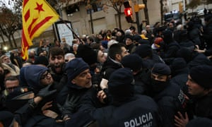 Catalan Mossos d'Esquadra officers scuffle with demonstrators as they cordon off the area around Lleida museum.