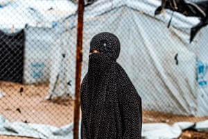 A veiled woman looks on during the release of people suspected of being related to Islamic State fighters from the Kurdish-run Al Hol camp in al-Hasakeh governorate in north-east Syria in January. Shamima Begum, who left Britain as a schoolgirl to join Isis in Syria, is imprisoned in the camp. Last week she failed in an appeal to the supreme court to restore her British citizenship. The judgment is a critical – and controversial – test case of the policy to strip citizenship from Britons who went to join Isis and are being detained by Syrian Kurdish groups without trial.