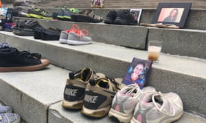 Shoes of those who died of an opioid overdose on the steps of the West Virginia Capitol in Charleston. In the US more than 60,000 people died of opioid overdoses in 2016 alone.