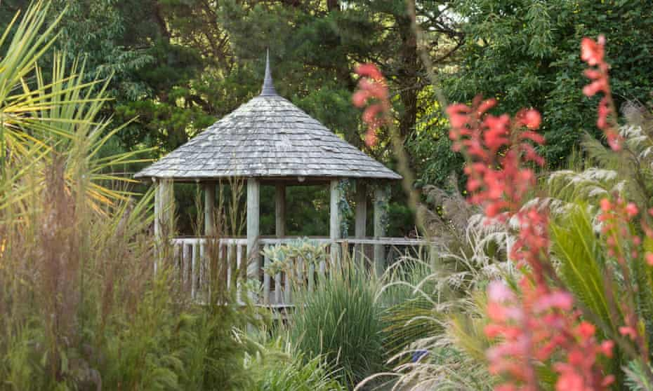 The gazebo lookout in the dry garden surrounded by mixed grasses and watsonia.