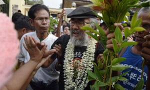 Myanmar political prisoner Thet Wai greets sympathisers outside Insein prison in Yangon following his release.