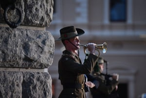 A soldier plays The Last Post during the Anzac Day dawn service at the National War Memorial in Adelaide.