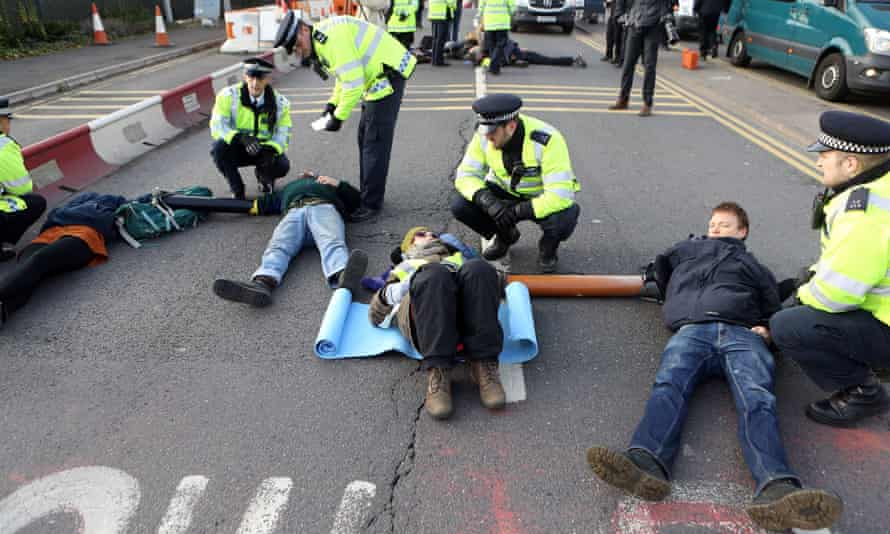 RisingUp! protesters lock themselves together on the M4 spur road near Heathrow airport.