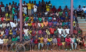 Locals watch a mixed christian and muslim football match in Boda, Central African Republic