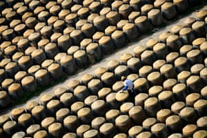 A worker among rows of barrels