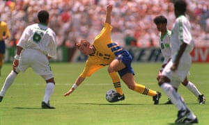 Tomas Brolin retains the ball while reclaiming his balance for Sweden against Saudi Arabia at the 1994 World Cup.