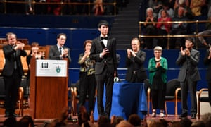 Eric Lu receives first prize at the 2018 Leeds international piano competition final.