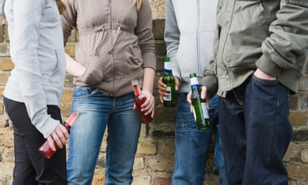 Teenagers with bottles of alcohol