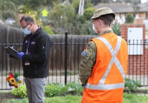 ADF personnel and a Victorian Department of Human Services officer doorknock houses in St Albans, Melbourne