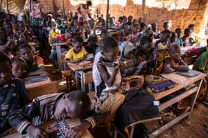 Kaya, Burkina Faso. Pupils attend a lesson at Koum-Lakre primary school. Approximately 1,000 displaced people have taken up residence on its two-hectare site