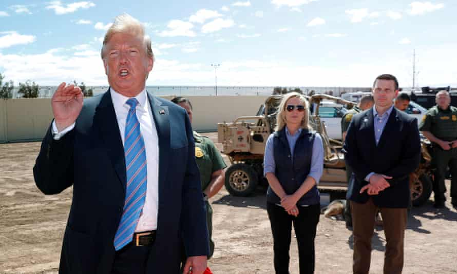 Donald Trump speaks in Calexico, California, while the then homeland security secretary, Kirstjen Nielsen, watches flanked by her acting successor, Kevin McAleenan.