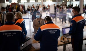 Passengers arriving at Charles de Gaulle airport in Paris, France. People arriving from the UK will have to quarantine.