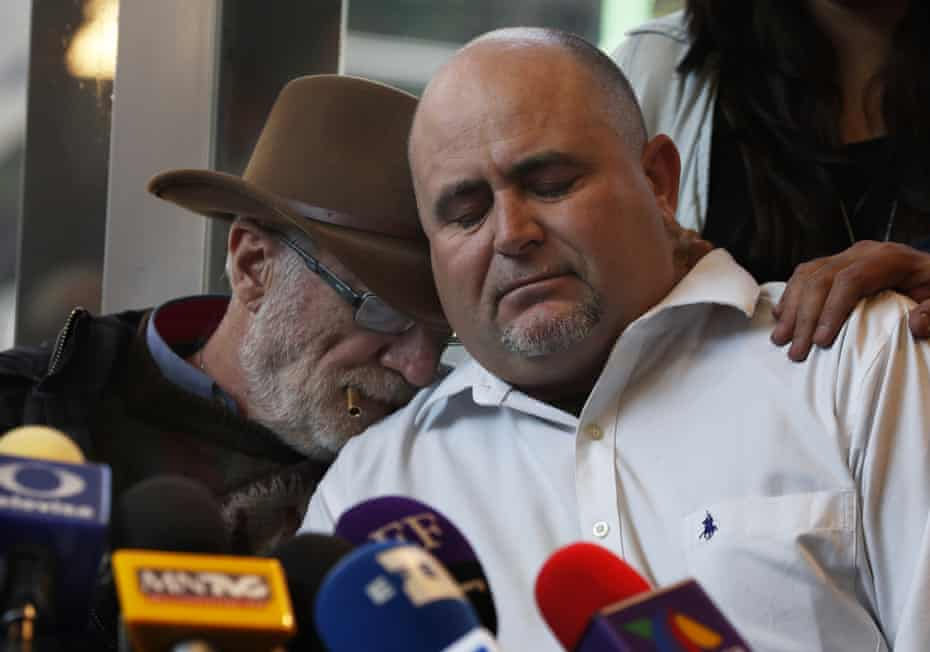Mexican writer and activist Javier Sicilia, left, comforts Julian LeBarón, who lost relatives and friends in the November 2019 ambush in northern Mexico, during a press conference in Mexico City, on 9 January.