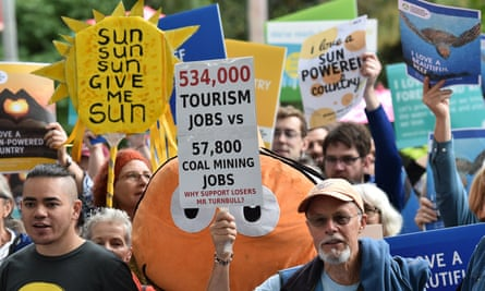 Protesters rally in Melbourne on Monday after the federal government granted Indian company Adani conditional approval of a $1bn loan for a rail line between the Carmichael coalmine and a port in north Queensland.