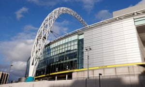the wembley arch is seen from outside the stadium ahead.