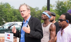 Lawrence Lessig campaigns outside the Ferguson police department in Missouri last month.