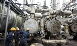 Workers at Nigeria's oldest refinery, in Port Harcourt. The country has 445,000 b/d of installed refining capacity, but its refineries seldom operate at capacity.