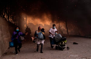 People flee a major fire in the Moria migrants camp, Lesbos, Greece