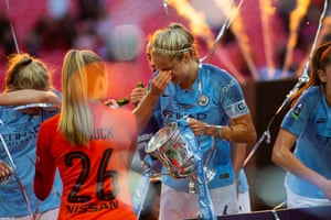 City captain Steph Houghton wipes the champagne from her eyes.