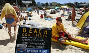 A sign warns bathers of the extreme heat on Bondi Beach, in Sydney, Australia.