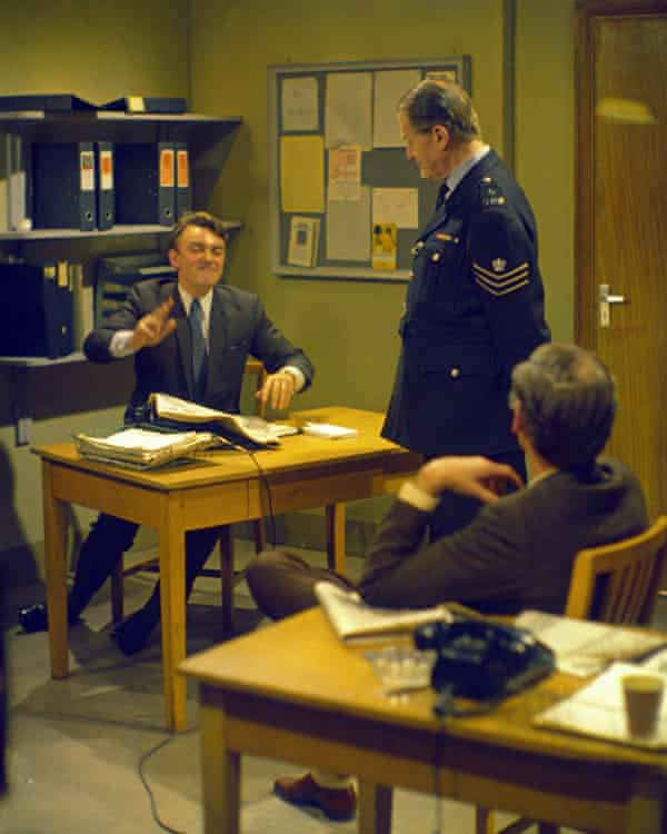 Storylines in Dixon of Dock Green became more up to date as the 60s progressed, and the focus moved from Sergeant Dixon (standing), played by Jack Warner, to the younger detective Crawford (seated at desk), played by Peter Byrne.
