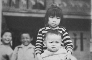Archival photo of Nanfu Wang and her brother used in One Child Nation.