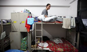 a worker rests in a dormitory at foxconn shenzhen