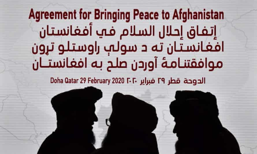 Members of the Taliban delegation gather ahead of the signing ceremony with the US in Doha, Qatar, on 29 February.