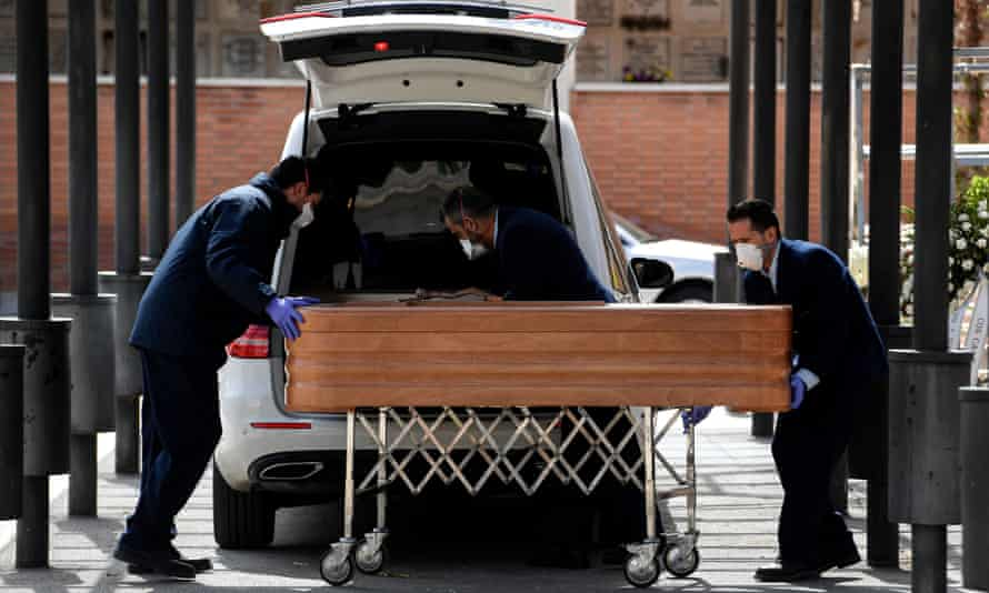 The coffin of a coronavirus victim is wheeled into the crematorium of La Almudena cemetery in Madrid.