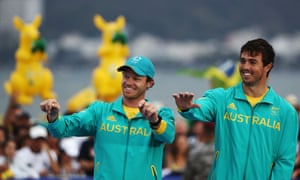 Nathan Outteridge of Australia and Iain Jensen of Australia celebrate after winning the silver in the Men's 49er class at the Marina da Gloria on Day 13 of the 2016 Rio Olympic Games on August 18, 2016 in Rio de Janeiro, Brazil. (Photo by Clive Mason/Getty Images)