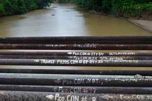 Shortlisted: Emanuele Giovagnoli. Oil pipelines run along a bridge over the Shiripuno river in the Yasuni national park. Oil pipelines run through the Ecuadorian rainforest to transport oil from pumping stations to oil developments.