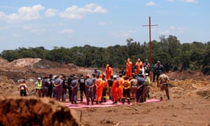 Rescue workers attend a mass for victims the accident on 1 February.