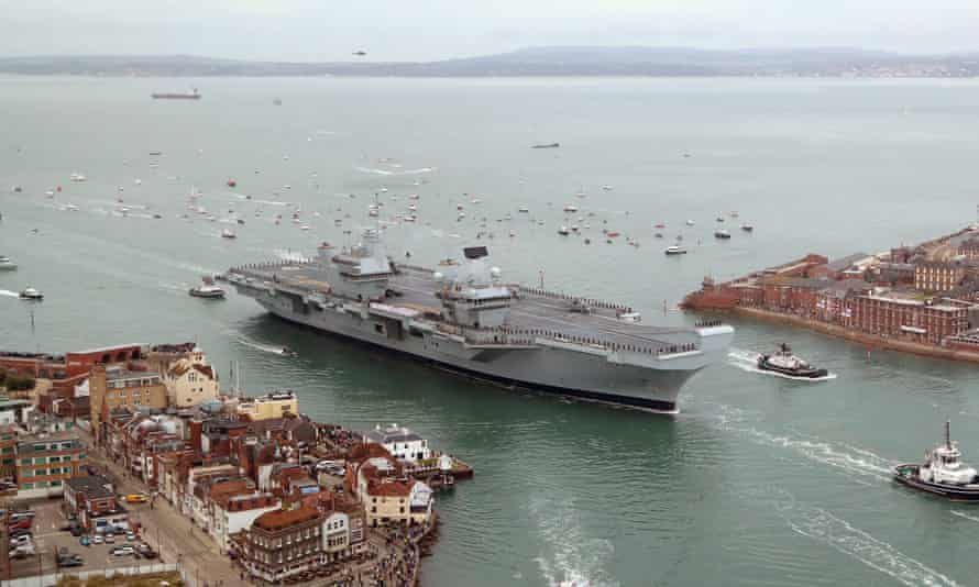 HMS Queen Elizabeth, the UK's newest aircraft carrier, arriving in Portsmouth in 2017.