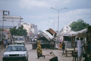 Daily life in 1992 in Mogadishu, where conflict, drought and food insecurity led to the US initiative Operation Restore Hope, aimed at protecting humanitarian workers from clan violence. Photograph: Patrick Robert/Sygma/Getty Images
