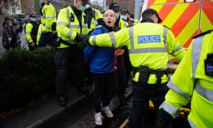 Police arrest a man during an anti-lockdown protest in Bristol