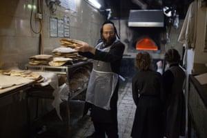 An Orthodox Jewish man is packing the Matza bread