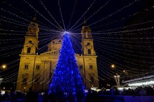 A Christmas tree is lit up in front of the Basilica of St Stephen in Budapest, Hungary