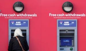 A customer uses an RBS-branded Link cash machine