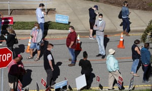 Voters wait in line in Cary, North Carolina on 15 October 2020.