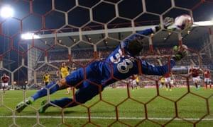 Lucas Perez scores Arsenal's 2nd goal from the penalty spot past of Vladimir Stojkovic of Nottingham Forest