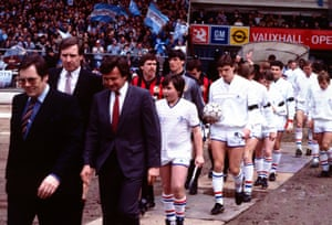Chelsea Manager John Hollins and Manchester City Manager Billy McNeill lead out the teams.
