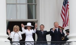 Brigitte Macron, Melania Trump, Emmanuel Macron and Donald Trump wave from the White House balcony.