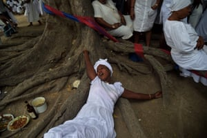 Souvenance, Haiti: A woman lies in a trance during a Vodou ceremony