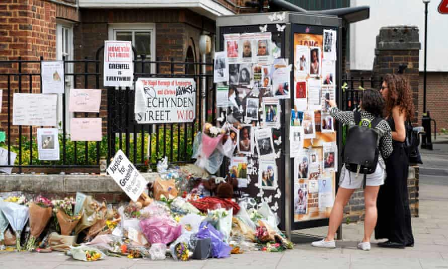 Tributes and missing posters near the site of the Grenfell Tower blaze in west London.