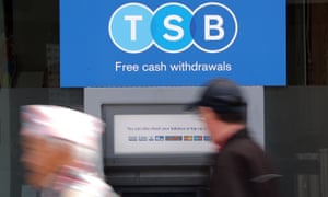 A man uses a TSB cash machine in Ashford, Kent.