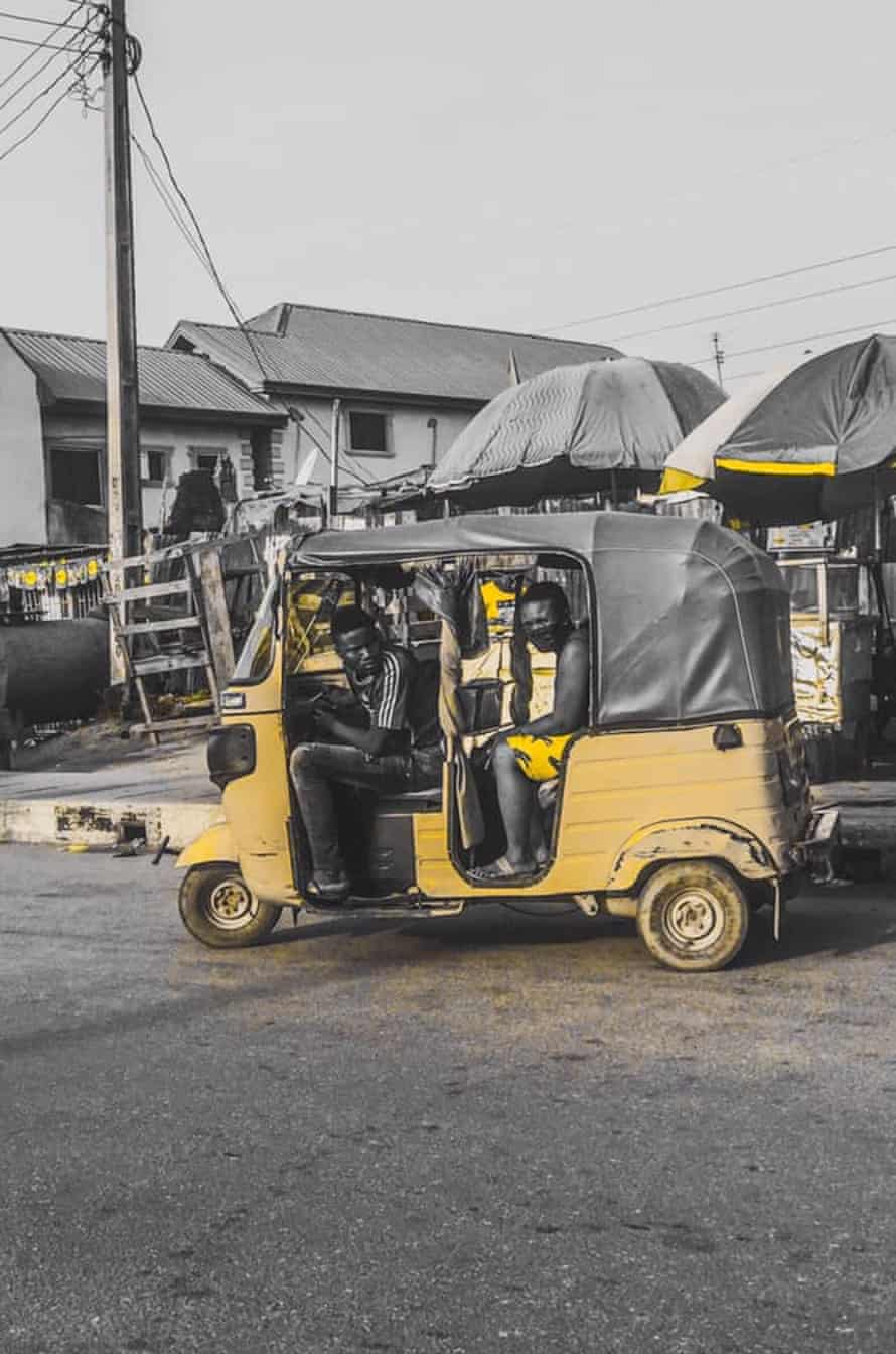 An auto-rickshaw outside the market in Orile.