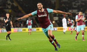 Andy Carroll wheels away in delight after scoring West Ham's fourth goal against Swansea to confirm a third Premier League win in a row for Slaven Bilic's side.